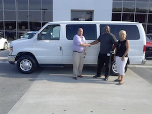 o.c_welch_iii_presents_wagon_to_kenneth_brown_coordinator_of_street_outreach_program_and_linda_hilts_director_of_park_place_outreach.jpg