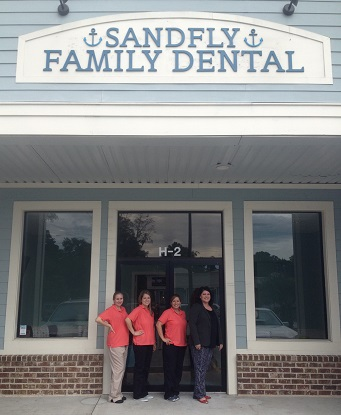 angela_canfield_dds_and_staff_out_front_of_sandfly_family_dental_office_resized.jpg