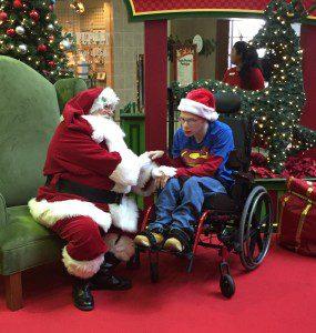Savannah Mall Caring Santa meets with Michael Robinson