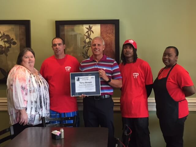 CAPTION: (LEFT TO RIGHT) Sandra Eury (Hiring Manager), Sidney Benaske (Buffet Runner), Terry Nickell (Owner), Narconda Bell (Cook), and Shona Wilkins (Cook)