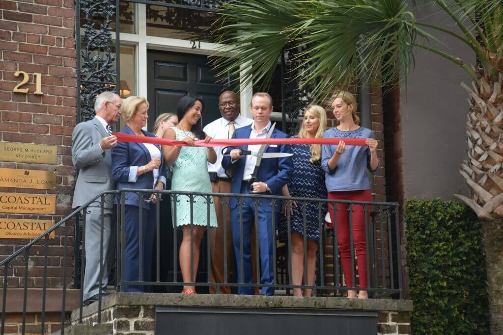 CAPTION: Sam Hubbard, Owner and Principal, cuts the ribbon at the grand opening of Coastal Divorce Advisors, LLC, a recently launched business that specializes in providing professional financial guidance to those going through a divorce. The office is located at 21 East York Street, Savannah, GA. (LEFT TO RIGHT) Terry Hubbard; Mary Hubbard; Amanda Love; Monica Baussan Hubbard; Jabron Webster, Chamber Ambassador; Sam Hubbard, Owner and Principal of Coastal Divorce Advisors; Genna Tober, Savannah Chamber Member Services Coordinator; and Hannah Burnsed, Chamber Ambassador.