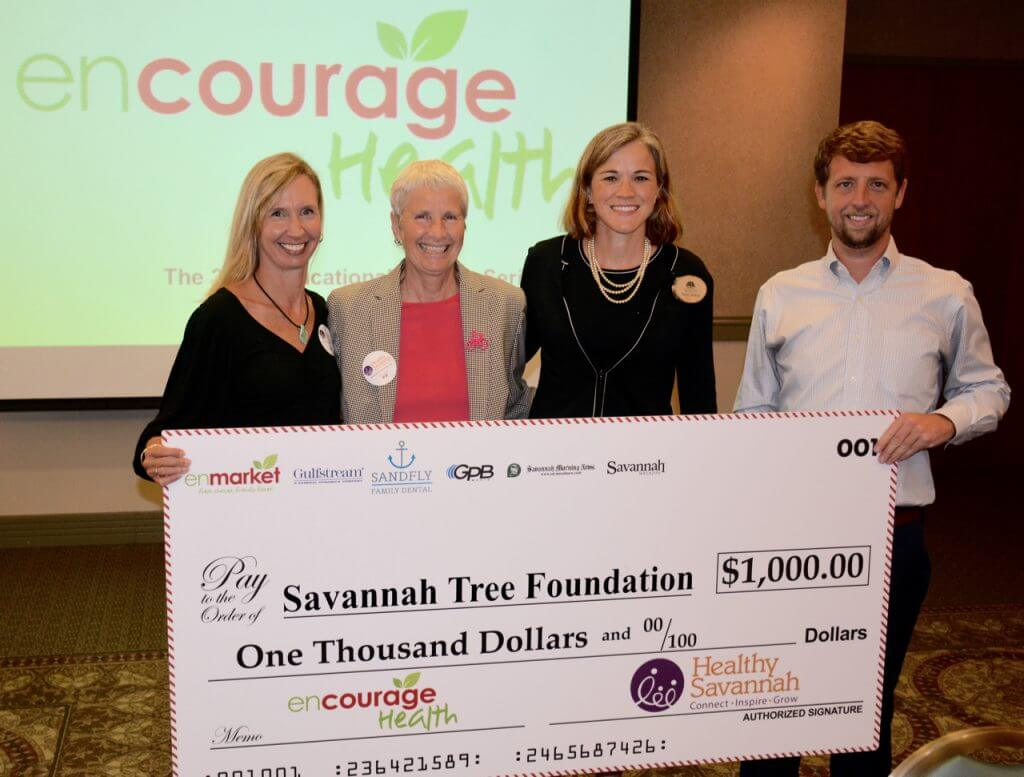 Enmarket presents Savannah Tree Foundation %241000 check at Encourage Health Series