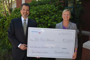 Pictured left to right: Chris Sotus, Resident Director for Merrill Lynch presented a $12,500 check from Bank of America to Julie Wade, Executive Director of Park Place Outreach Youth Emergency Shelter.