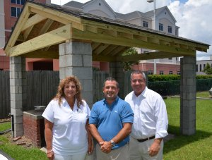 Pictured (Left to Right): Kim Thomas, Chris Tilton and Andrew DeWitt of the Dewitt Tilton Group in front of the newly built BBQ Pitt Roof for the Savannah Jaycees.