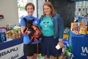 Pictured (left to right) Susan Schake, volunteer at Jasper Animal Rescue Mission; Georgia, a one year old terrier mix located at Jasper Animal Rescue Mission; and Jill Jauch, Marketing and Advertising Manager at Peacock Automotive.
