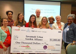 Enmarket and Healthy Savannah presents check to SUGA