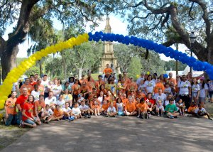 Families of Lowcountry Down Syndrome Society under the arch during the Buddy Walk in Savannah