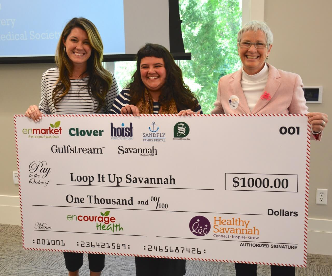 Enmarket and Healthy Savannah presents check to Loop It Up Savannah