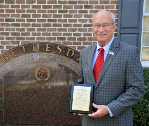 Bethesda Academy President Michael Hughes Holds GOAL Award