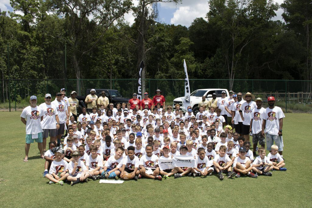 Group photo at Kids and Pros Football Camp Presented by Peacock Automotive
