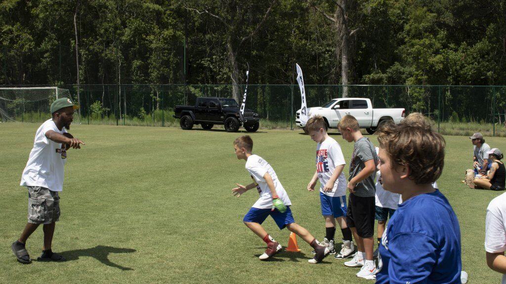 Peacock Automotive Supports Kids and Pros Football Camp