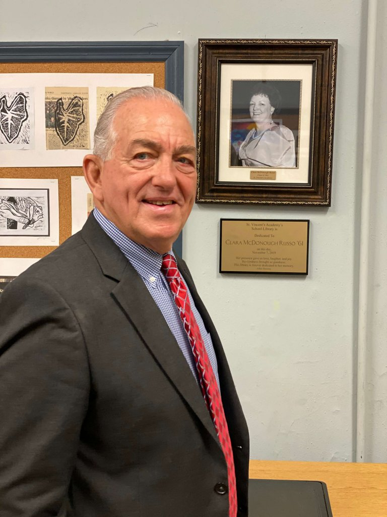 Charles Russo stands in front of the plaque honoring his late wife Clara at the St. Vincent's Academy library dedication ceremony