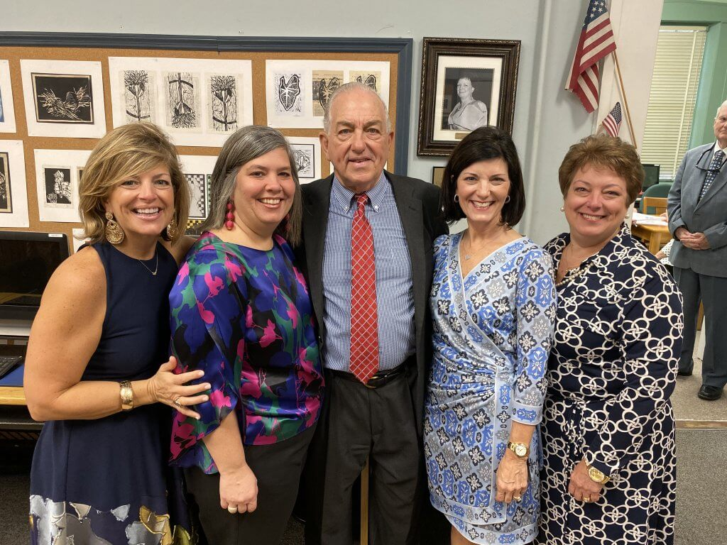 Charles Russo with his four daughters at the St. Vincent's Academy library dedication ceremony